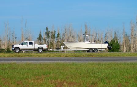 Truck Hauling Boat On Trailer
